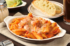 Chicken Parmigiana. On penne with Italian toast and a salad Royalty Free Stock Image