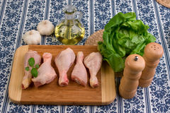 Chicken parts on wood board Royalty Free Stock Photo