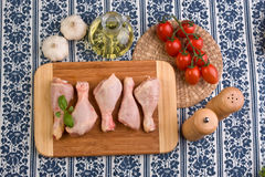 Chicken parts on wood board Royalty Free Stock Image