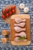 Chicken parts on wood board Royalty Free Stock Images