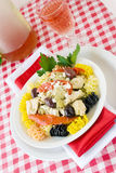 Chicken and Pasta. Healthful Mediterranean chicken and pasta dinner. Made with roasted sweet bell pepper, kalamata olives, feta cheese, multi colored pasta Royalty Free Stock Image