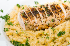 Chicken and pasta dinner stock images