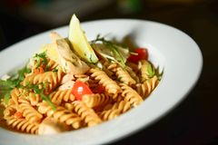Chicken Pasta Dinner. With Some Greens and Vegetables. Chicken Pasta Plate Closeup Stock Image