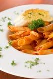 Chicken pasta. With garlic bread Stock Photos