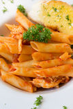 Chicken pasta. With garlic bread Royalty Free Stock Images