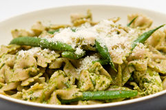 Chicken pasta with green bean and parmesan. Chicken tortellini pasta with pesto cream sauce and green beans Royalty Free Stock Image