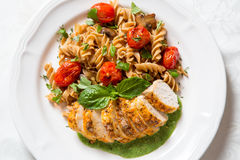 Chicken and pasta with pesto cream sauce Royalty Free Stock Photo