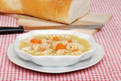 Chicken pasta soup with fresh baked bread Stock Photo