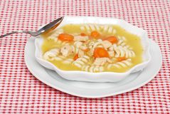 Chicken pasta soup with spoon Stock Photography