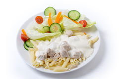 Chicken and pasta with white sauce dinner Royalty Free Stock Photos