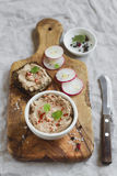 Chicken pate in a bowl and a sandwich with pate Royalty Free Stock Images