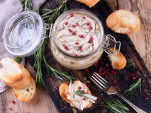 Chicken pate in glass jar and toast bread on rustic kitchen board Stock Photos