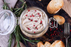Chicken pate in glass jar and toast bread on rustic kitchen board Stock Photo