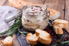 Chicken pate in glass jar and toast bread on rustic kitchen board Stock Image