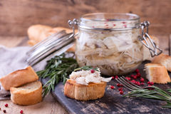 Chicken pate in glass jar and toast bread on rustic kitchen board Stock Images
