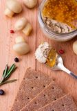 Chicken pate in jar and crispbread on wood cutting board Royalty Free Stock Images