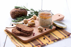 Chicken pate in jar and sliced bread with mustard Stock Photo