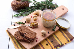 Chicken pate in jar and sliced bread with mustard Stock Image
