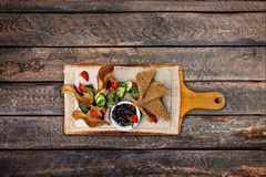 Chicken pate with plum sauce, served with croutons. Top view stock image