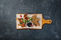 Chicken pate with plum sauce, served with croutons. Top view royalty free stock photography