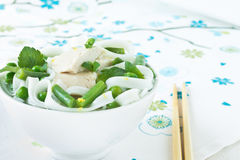 Chicken and peas laksa with mint leaves Stock Photography