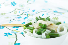 Chicken and peas laksa with mint leaves Stock Photo