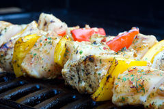Chicken and pepper kebabs on the barbecue Stock Photography