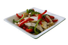 Chicken and Pepper salad. Chicken with green and red pepper salad in a square bowl on a white background - easy to isolate stock image