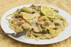 Chicken Piccata Linguine Stock Photos