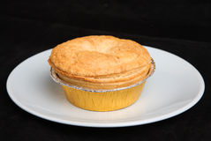 Chicken Pie. Individual chicken pie isolated on black background Stock Photo