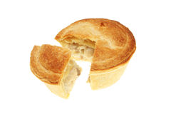 Chicken pie. With a slice cut out isolated on white stock image