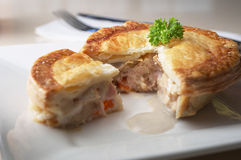 Chicken pie. With carrot and gravy stock images