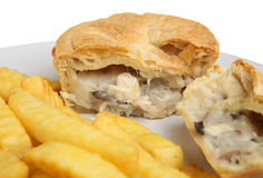 Chicken Pie & Chips. Individual chicken & mushroom pie with chips. Selective focus on pie Royalty Free Stock Image