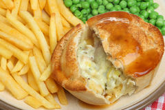 Chicken Pie with Chips and Peas Royalty Free Stock Image