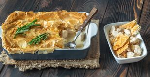 Chicken pie with philo. On the wooden table royalty free stock photography
