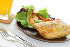 Chicken pie with salad and orange juice Stock Images