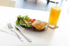 Chicken pie with salad and orange juice Royalty Free Stock Images