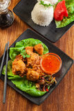 Chicken pieces in batter with sweet and sour sauce Stock Images