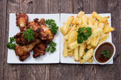 Chicken Pieces and French Fries Royalty Free Stock Photos