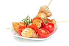 Chicken pieces grilled on skewers. Isolated on white background Royalty Free Stock Image