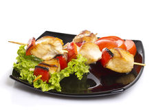 Chicken pieces grilled on skewers isolated Royalty Free Stock Photos
