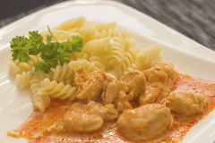 Chicken pieces with Pasta Royalty Free Stock Photos