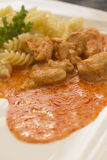 Chicken pieces with Pasta in Paprika Cream Sauce Royalty Free Stock Image