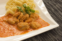 Chicken pieces with Pasta in Paprika Cream Sauce Royalty Free Stock Images