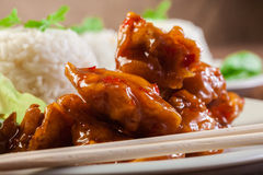 Chicken pieces with rice and sweet and sour sauce Royalty Free Stock Image