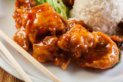 Chicken pieces with rice and sweet and sour sauce Royalty Free Stock Photography