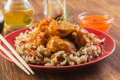 Chicken pieces with rice and sweet and sour sauce Stock Images