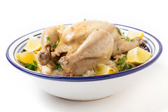Chicken on pilaf rice in a Tunisian serving bowl Royalty Free Stock Images