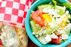 Chicken pita wrap. With tomato, rice and tzatziki and a side greek salad Stock Images