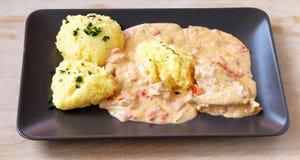 Chicken polenta (mamaliga-puliszka) Stock Images